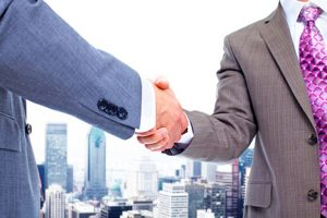 Business deal. Handshake. Urban background.